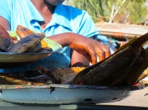 All kinds of fish being sold through our car window, talk about convenience