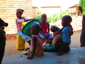 Kids in Nsanje take a break from their chores and sit in the shade at a local shop owned by a SACCO member