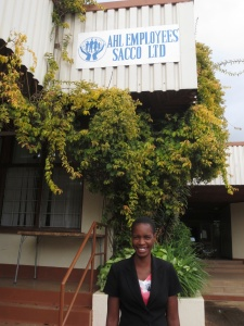 Grace stands outside her beautiful AHL SACCO branch